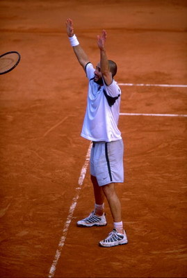 6 Jun 1999:  Andre Agassi of the United States celebrates victory during the 1999 French Open Final match against Andrei Medvedev of the Ukraine played at Roland Garros in Paris, France.  The match finished in an emotional victory for Andre Agassi. \ Mand