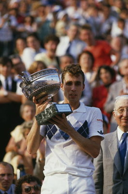 Czech tennis player Ivan Lendl with the trophy after winning the men's singles final of the Tournoi de Roland-Garros (French Open), at the Stade Roland Garros, Paris, June 1984. Lendl beat John McEnroe of the USA to win the match 3-6, 2-6, 6-4, 7-5, 7-5.