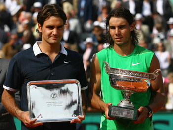 PARIS - JUNE 08:  Roger Federer (L) of Switzerland and Rafael Nadal of Spain with their trophies after the Men's Singles Final match on day fifteen of the French Open at Roland Garros on June 8, 2008 in Paris, France.  (Photo by Julian Finney/Getty Images