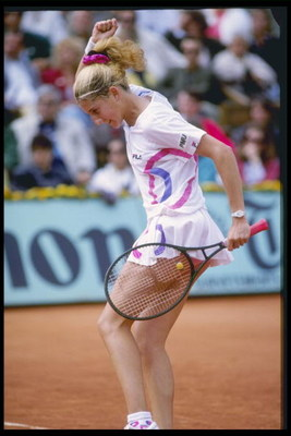 Jun 1990: Monica Seles of Yugoslavia celebrates during the French Open championships at Roland Garros, Paris.                                                 Mandatory Credit: Allsport UK