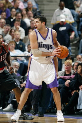SACRAMENTO, CA - JANUARY 20:  Predrag Stojakovic #16 of the Sacramento Kings holds the ball during the game against the Portland Trail Blazers at Arco Arena on January 20, 2004 in Sacramento, California.  The Trail Blazers won 109-104.  NOTE TO USER: User
