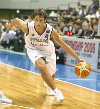 SAPPORO, JAPAN - AUGUST 20: Marco Belinelli #4 of Italy dribbles to the basket against Slovenia during the preliminary round of FIBA World Championships 2006 on August 20, 2006 in Sapporo, Japan. The Championship takes place from August 19 to September 3