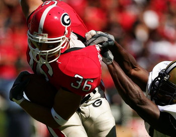 ATHENS, GA - OCTOBER 14:  Brannan Southerland #36 of the Georgia Bulldogs is tackled by Jonathan Goff #47 of the Vanderbilt Commodores during their game at Sanford Stadium on October 14, 2006 in Athens, Georgia.  (Photo by Scott Halleran/Getty Images)