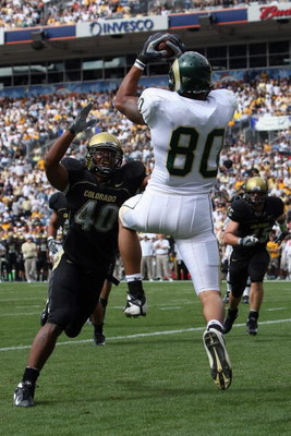 DENVER - SEPTEMBER 1:  Kory Sperry #80 of the Colorado State Rams catches a touchdown pass against Brad Jones #40 of the Colorado Buffaloes at INVESCO Field at Mile High on September 1, 2007 in Denver, Colorado. Colorado won 31-28 in overtime. (Photo by D