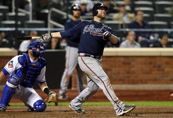 NEW YORK - MAY 12:  Brian McCann #16 of the Atlanta Braves bats against the New York Mets on May 12, 2009 at Citi Field in the Flushing neighborhood of the Queens borough of New York City. The Mets defeated the Braves 4-3 in 10 innings.  (Photo by Jim McI