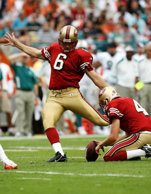MIAMI - DECEMBER 14:  Place kicker Joe Nedney #6 of the San Francisco 49ers kicks a field goal out from under the hold of punter Andy Lee #4 while taking on the Miami Dolphins at Dolphin Stadium on December 14, 2008 in Miami, Florida. The Dolphins defeate