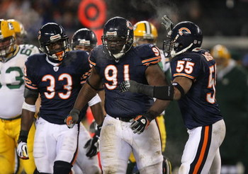 CHICAGO - DECEMBER 22: Charles Tillman #33, Tommie Harris #91 and Lance Briggs #55 of the Chicago Bears celebrate a tackle for a loss against the Green Bay Packers on December 22, 2008 at Soldier Field in Chicago, Illinois. The Bears defeated the Packers