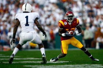 PASADENA, CA - JANUARY 01:  Damian Williams #18 of the USC Trojans goes up against A.J. Wallace #1 of the Penn State Nittany Lions during the 95th Rose Bowl Game presented by Citi on January 1, 2009 at the Rose Bowl in Pasadena, California.  (Photo by Jef