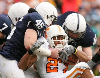 TAMPA, FL - JANUARY 01:  Arian Foster #27 of Tennessee Volunteers is tackled by Sean Lee #45 and his Penn State Nittany Lions teammates during the Outback Bowl at Raymond James Stadium on January 1, 2007 in Tampa, Florida.  (Photo by Scott Halleran/Getty 
