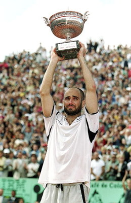 6 Jun 1999:  Andre Agassi of the USA lifts the trophy high above his head after defeating Andrei Medvedev of the Ukraine to win the men's singles final of the French Open at Roland Garros in Paris, France. Mandatory Credit: Al Bello  /Allsport