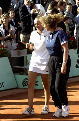 5 Jun 1999:  Martina Hingis of Switzerland is consoled by her mother and led back onto court after being defeated during the 1999 French Open Final match against Steffi Graf of Germany played at Roland Garros in Paris, France.  The match finished with Ste