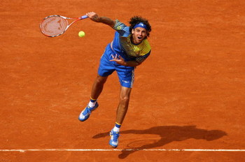 PARIS - MAY 25:  Gustavo Kuerten of Brazil serves during the Men's Singles first round match against Paul-Henri Mathieu of France on day one of the French Open at Roland Garros on May 25, 2008 in Paris, France. The French Open with be Kuertens last tourna