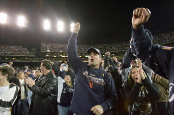 DETROIT - OCTOBER 14:  Fans of the Detroit Tigers celebrates after winning Game Four of the American League Championship Series against the Oakland Athletics on October 14, 2006 at Comerica Park in Detroit, Michigan. (Photo by Jed Jacobsohn/Getty Images)