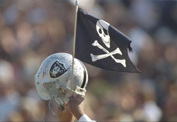9 Jan 1994:  A Los Angeles Raiders fan waves a helmet and flag during a playoff game against the Denver Broncos at the Los Angeles Memorial Coliseum in Los Angeles, California.  The Raiders won the game, 42-24. Mandatory Credit: Al Bello  /Allsport