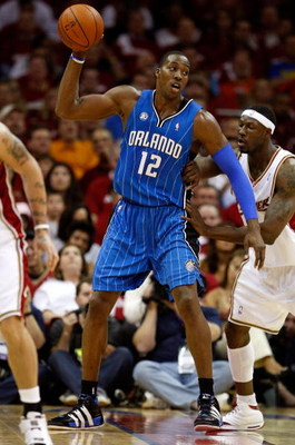 CLEVELAND - MAY 20: Dwight Howard #12 of the Orlando Magic handles the ball against Ben Wallace #4 of the Cleveland Cavaliers in Game One of the Eastern Conference Finals during the 2009 Playoffs at Quicken Loans Arena on May 20, 2009 in Cleveland, Ohio.