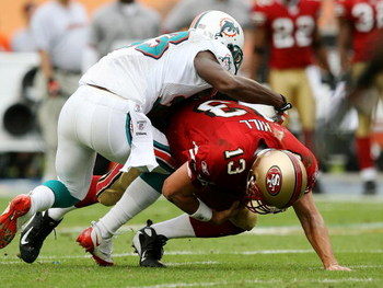 MIAMI - DECEMBER 14:  Quarterback Shaun Hill #13 of the San Francisco 49ers is sacked by cornerback Nathan Jones #33 of the Miami Dolphins at Dolphin Stadium on December 14, 2008 in Miami, Florida.  (Photo by Doug Benc/Getty Images)