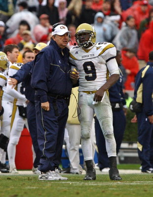 ATHENS, GA - NOVEMBER 29:  Head coach Paul Johnson and quarterback Josh Nesbitt #9 of the Georgia Tech Yellow Jackets share a discussion during a timeout in the game against the Georgia Bulldogs at Sanford Stadium on November 29, 2008 in Athens, Georgia.
