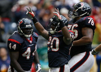 HOUSTON - DECEMBER 28:  Steve Slaton #20 of the the Houston Texans celebrates his touchdown for a 31-17 lead with teammates Duane Brown #76 and Vonta Leach #44 against the Chicago Bears during the second half at the Reliant Stadium December 28, 2008 in Ho
