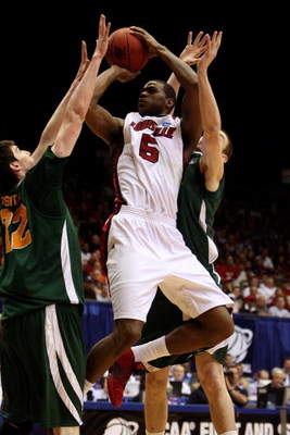 DAYTON, OH - MARCH 22: Earl Clark #5 of the Louisville Cardinals drives to the hoop against the Siena Saints during the second round of the NCAA Division I Men's Basketball Tournament at the University of Dayton Arena on March 22, 2009 in Dayton, Ohio.  (