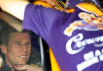 CONCORD, NC - MAY 15:  Jamie McMurray, driver of the #26 Crown Royal Ford, sits in his car during practice for the NASCAR Sprint All-Star Race on May 15, 2009 at Lowe's Motor Speedway in Concord, North Carolina.  (Photo by Drew Hallowell/Getty Images for