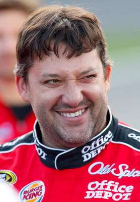 CONCORD, NC - MAY 21: Tony Stewart, driver of the #14 Office Depot Chevrolet, smiles during qualifying for the NASCAR Sprint Cup Series Coca-Cola 600 on May 21, 2009 at Lowe's Motor Speedway in Concord, North Carolina.  (Photo by Geoff Burke/Getty Images