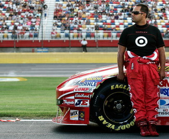 CONCORD, NC - MAY 21:  Juan Pablo Montoya stands next to the #42 Target Chevrolet on the grid during qualifying for the NASCAR Sprint Cup Series Coca-Cola 600 on May 21, 2009 at Lowe's Motor Speedway in Concord, North Carolina.  (Photo by Jason Smith/Gett