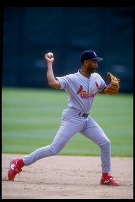 25 Jul 1993:  Shortstop Ozzie Smith of the St. Louis Cardinals throws the ball during a game against the Colorado Rockies at Coors Field in Denver, Colorado.  Mandatory Credit: Tim de Frisco  /Allsport
