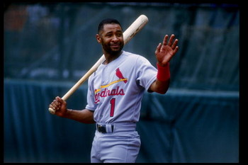 25 Jul 1993: Shortstop Ozzie Smith of the St. Louis Cardinals carries a bat over his shoulder and waves during a game against the Colorado Rockies at Coors Field in Denver, Colorado.