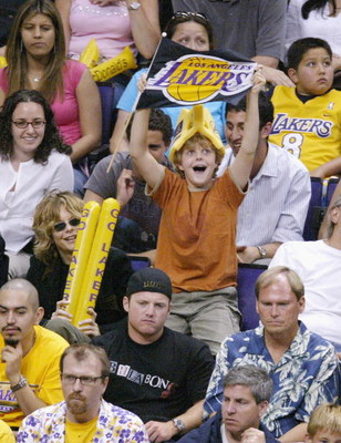 LOS ANGELES - MAY 31:  Actress Meg Ryan (glasses) and son Jack attend Game Six of the NBA Western Conference Finals between the Minnesota Timberwolves and the Los Angeles Lakers on May 31, 2004 in Los Angeles, California. (Photo by Vince Bucci/Getty Image