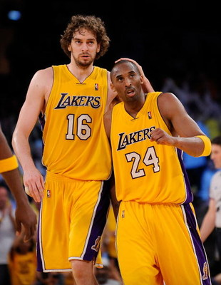 LOS ANGELES, CA - MAY 19:  (L-R) Pau Gasol #16 and Kobe Bryant #24 of the Los Angeles Lakers walk to the bench late in the fourth quarter against the Denver Nuggets in Game One of the Western Conference Finals during the 2009 NBA Playoffs at Staples Cente