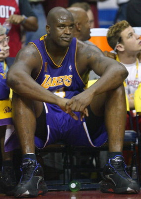 AUBURN HILLS, MI - JUNE 15:  Shaquille O'Neal #34 of the Los Angeles Lakers looks on from the bench in the fourth quarter of game five of the 2004 NBA Finals against the Detroit Pistons on June 15, 2004 at The Palace of Auburn Hills in Auburn Hills, Michi