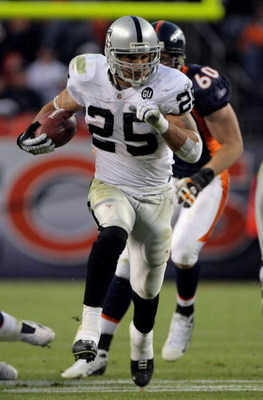 DENVER - NOVEMBER 23:  Running back Justin Fargas #25 of the Oakland Raiders carries the ball against the Denver Broncos during week 12 NFL action at Invesco Field at Mile High on November 23, 2008 in Denver, Colorado. Fargas rushed for 107 yards as the R
