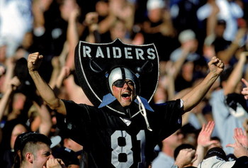 24 Oct 1999: A fan of the Oakland Raiders cheers in the stands as he wears the logo during a game against the New York Jets at the Network Coliseum in Oakland, California. The Raiders defeated the Jets 24-23. Mandatory Credit: Jon Ferrey  /Allsport