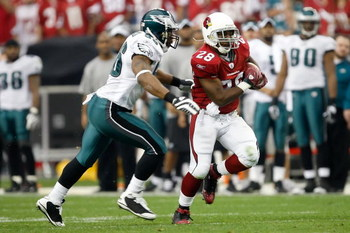 GLENDALE, AZ - JANUARY 18:  Running back J.J. Arrington #28 of the Arizona Cardinals runs the ball by linebacker Akeem Jordan #56 of the Philadelphia Eagles in the second quarter during the NFC championship game on January 18, 2009 at University of Phoeni