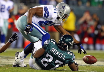 PHILADELPHIA - DECEMBER 28:  Terrell Owens #81 of the Dallas Cowboys can't hold onto a pass as he is defended by Quintin Mikell #27 of the Philadelphia Eagles on December 28, 2008 at Lincoln Financial Field in Philadelphia, Pennsylvania.  (Photo by Jim Mc