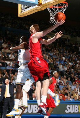 WESTWOOD, CA - JANUARY 15:  Chase Budinger #34 of the Arizona Wildcats drives to the basket past Darren Collison #2 of the UCLA Bruins during the college basketball game at Pauley Pavilion on January 15, 2009 in Westwood, California. The Bruins defeated t