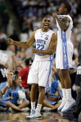 DETROIT - APRIL 06:  Wayne Ellington #22 and Deon Thompson #21 of the North Carolina Tar Heels celebrate in the final minute of their 89-72 win against the Michigan State Spartans during the 2009 NCAA Division I Men's Basketball National Championship game