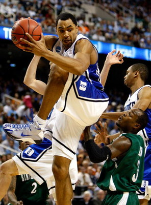 GREENSBORO, NC - MARCH 19:  Gerald Henderson #15 of the Duke Blue Devils grabs a rebound against Malik Alvin #3 of the Binghamton Bearcats during the first round of the NCAA Division I Men's Basketball Tournament at the Greensboro Coliseum on March 19, 20