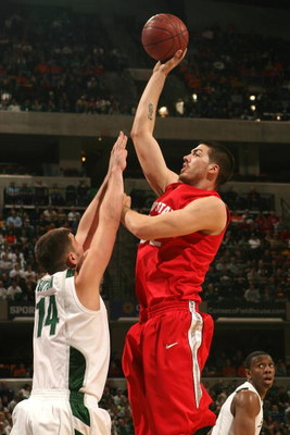 INDIANAPOLIS - MARCH 14:  B.J. Mullens #32 of the Ohio State Buckeyes attempts a shot against Goran Suton #14 of the Michigan State Spartans during their semifinal game of the Big Ten Men's Basketball Tournament at Conseco Fieldhouse on March 14, 2009 in