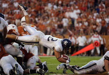 AUSTIN, TX - SEPTEMBER 20:  James Casey #12 of the Rice Owls dives during the game against the Texas Longhorns on September 20, 2008 at Darrell K Royal-Texas Memorial Stadium in Austin, Texas. Texas won 52-10. (Photo by Brian Bahr/Getty Images)