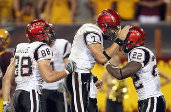 TEMPE, AZ - SEPTEMBER 15: Quarterback Kevin O'Connell #7 of the San Diego State Aztecs celebrates with  Lynell Hamilton#22 during the game against the Arizona State Sun Devils on September 15, 2007 at Sun Devil Stadium in Tempe, Arizona.  (Photo by Stephe