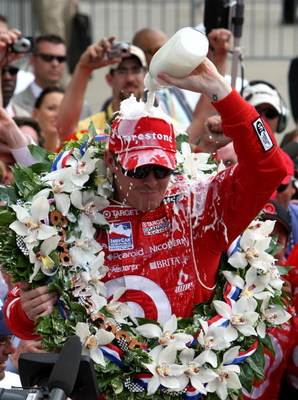 INDIANAPOLIS - MAY 25:  Scott Dixon driver of the #9 Target Chip Ganassi Racing Honda Dallara pours milk on his head to celebrate winning the IndyCar Series 92nd running of the Indianapolis 500 at Indianapolis Motor Speedway on May 25, 2008 in Indianapoli