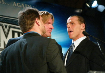NEW YORK - MARCH 11:  (L-R) Wrestlers Chris Benoit, Triple H and Shawn Michaels attend a press conference to promote Wrestlemania XX at Planet Hollywood March 11, 2004 in New York City.  (Photo by Peter Kramer/Getty Images)