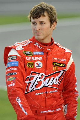 CONCORD, NC - MAY 21: Kasey Kahne, driver of the #9 Budweiser Dodge, stands on pit road during qualifying for the NASCAR Sprint Cup Series Coca-Cola 600 on May 21, 2009 at Lowe's Motor Speedway in Concord, North Carolina.  (Photo by John Harrelson/Getty I