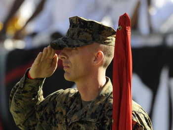 TAMPA, FL - DECEMBER 16: A National Guard member salutes the American Flag during pre-game ceremonies as the Tampa Bay Buccaneers host the Atlanta Falcons at the Raymond James Stadium  on December 16, 2007 in Tampa, Florida.  The Bucs won 37 - 3 and clinc