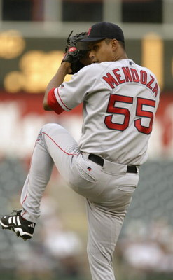 ARLINGTON, TEXAS - JULY 30:  Pitcher Ramiro Mendoza #55 of the Boston Red Sox winds up for the pitch during the American League game against the Texas Rangers at the Ballpark in Arlington on July 30, 2003 in Arlington, Texas.  The Rangers defeated the Red