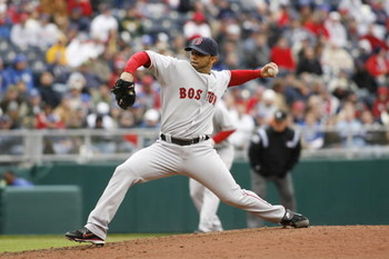 KANSAS CITY, MO - APRIL 5:  Pitcher J.C. Romero #32 of the Boston Red Sox throws a pitch against the Kansas City Royals on April 5, 2007 at Kauffman Stadium in Kansas City, Missouri.  Boston defeated the Royals 4-1. (Photo by G. Newman Lowrance/Getty Imag