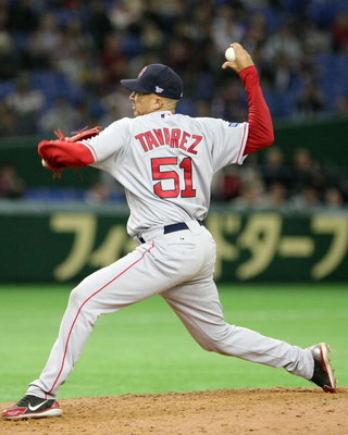 TOKYO - MARCH 23:  Pitcher Julian Tavarez #51 of Boston Red Sox  throws during a presason friendly between Boston Red Sox and Yomiuri Giants at Tokyo Dome on March 23, 2008 in Tokyo, Japan.  (Photo by Koichi Kamoshida/Getty Images)