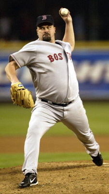 SEATTLE - AUGUST 26:   Starting pitcher David Wells #16 of the Boston Red Sox pitches against the Seattle Mariners on August 26, 2006 at Safeco Field in Seattle, Washington.  (Photo by Otto Greule Jr/Getty Images) 