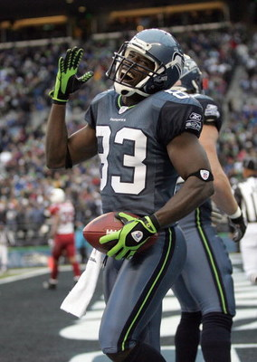 SEATTLE - DECEMBER 9: Deion Branch #83 of the Seattle Seahawks celebrates the touchdown against the Arizona Cardinals December 9, 2007 at Qwest Field in Seattle, Washington. The Seahawks defeated the Cardinals 42-21. (Photo by Otto Greule Jr/Getty Images)